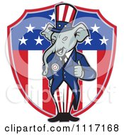 Cartoon Of A Retro Republican GOP Party Elephant Uncle Sam Holding A Thumb Up Over An American Shield Royalty Free Vector Clipart by patrimonio