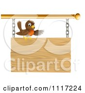 Cartoon Happy Robin Bird Presenting On A Wood Sign Royalty Free Vector Clipart