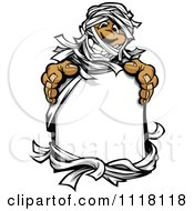 Cartoon Of A Happy Mummy Holding A Sign Royalty Free Vector Clipart