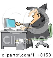 Halloween Vampire Using A Computer At An Office Desk