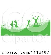 Clipart Of Green Silhouetted Happy Children Playing In A Meadow With Flowers And Butterflies Royalty Free Vector Illustration