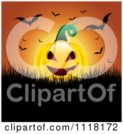 Clipart Of An Evil Halloween Jackolantern Pumpkin With Flying Bats Against An Orange Sunset Royalty Free Vector Illustration