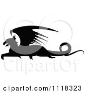 Clipart Of A Black Silhouetted Resting Griffin 2 Royalty Free Vector Illustration by Vector Tradition SM