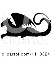 Clipart Of A Black Silhouetted Resting Griffin 3 Royalty Free Vector Illustration by Vector Tradition SM