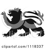 Clipart Of A Black Silhouetted Heraldic Lion Clawing Royalty Free Vector Illustration
