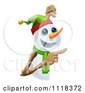 Clipart Of A Happy Christmas Snowman Pointing At A Sign Royalty Free Vector Illustration by AtStockIllustration