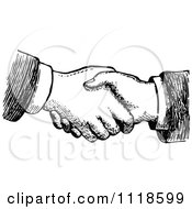 Clipart Of A Retro Vintage Black And White Hand Shake Royalty Free Vector Illustration by Prawny Vintage #COLLC1118599-0178