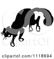 Clipart Of A Retro Vintage Black And White Scared Cat Jumping Royalty Free Vector Illustration