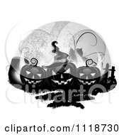 Clipart Of Black Halloween Jackolanterns With A Tombstone And Fence Against A Full Moon Royalty Free Vector Illustration