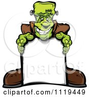 Cartoon Of A Halloween Happy Frankenstein Standing Behind A Sign Royalty Free Vector Clipart