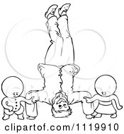 Clipart Of Retro Vintage Black And White Goops Kids By A Man Doing A Head Stand Royalty Free Vector Illustration by Prawny Vintage