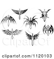 Clipart Of Black And White Tribal Winged Swords Royalty Free Vector Illustration by Vector Tradition SM