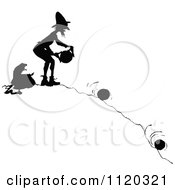 Clipart Of A Silhouetted Man Rolling Cheese Down A Hill Royalty Free Vector Illustration