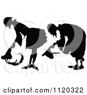 Clipart Of Silhouetted Men Bowing Royalty Free Vector Illustration