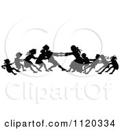 Clipart Of Silhouetted Children Playing Tug Of War Royalty Free Vector Illustration