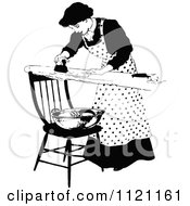 Clipart Of A Retro Vintage Black And White Domestic Housewife Ironing Laundry Royalty Free Vector Illustration