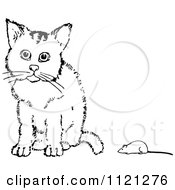 Clipart Of A Retro Vintage Black And White Cat And Toy Mouse Royalty Free Vector Illustration