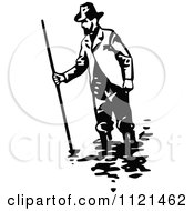 Clipart Of A Retro Vintage Black And White Klondiker Gold Rush Miner Man Wading Royalty Free Vector Illustration by Prawny Vintage