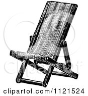 Clipart Of A Retro Vintage Black And White Folding Deck Chair Royalty Free Vector Illustration