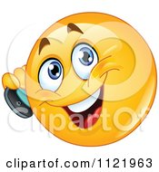 Cartoon Of A Chatty Emoticon Using A Cell Phone Royalty Free Vector Clipart
