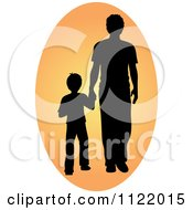 Silhouetted Father And Son Holding Hands In An Oval