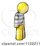Cartoon Of A Moping Yellow Man Prisoner Royalty Free Vector Clipart