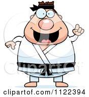 Cartoon Of A Chubby Black Belt Karate Man With An Idea Royalty Free Vector Clipart