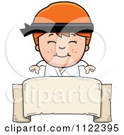 Cartoon Of A Happy Red Haired Martial Arts Karate Boy Over A Banner Sign Royalty Free Vector Clipart