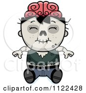 Cartoon Of A Happy Zombie Boy Sitting Royalty Free Vector Clipart