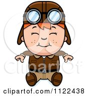 Cartoon Of A Happy Red Haired Aviator Pilot Boy Sitting Royalty Free Vector Clipart
