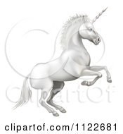 Clipart Of A White Rearing Unicorn Royalty Free Vector Illustration by AtStockIllustration
