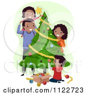 Cartoon Of A Happy Black Family Decorating A Christmas Tree Royalty Free Vector Clipart by BNP Design Studio