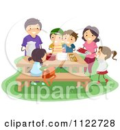 Cartoon Of A Happy Family Surrounding A Picnic Table Royalty Free Vector Clipart by BNP Design Studio