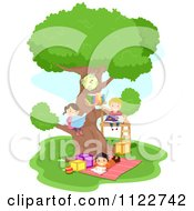 Happy Diverse School Children Reading At A Tree House