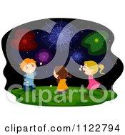 Cartoon Of Happy Children Watching Fireworks Royalty Free Vector Clipart by BNP Design Studio
