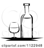 Clipart Of A Black And White Wine Bottle And Glass Royalty Free Vector Illustration