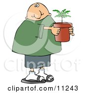 Man Holding A Small Tree Growing In A Pot Clipart Picture