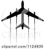 Clipart Of A Black Silhouetted Airplane And Trails 1 Royalty Free Vector Illustration