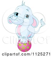 Cartoon Of A Cute Blue Elephant Balancing On A Ball Royalty Free Vector Clipart by Pushkin