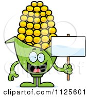 Cartoon Of A Corn Mascot Holding A Sign Royalty Free Vector Clipart