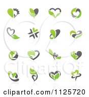 Clipart Of Green And Gray Organic Heart Love Icons With Reflections Royalty Free Vector Illustration