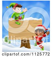 Clipart Of Energetic Christmas Elves By A Wooden Sign In A Winter Landscape Royalty Free Vector Illustration