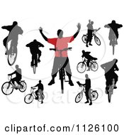 Clipart Of Silhouetted Men And Bicycles Royalty Free Vector Illustration