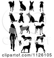 Clipart Of A Silhouetted Woman And Dogs Royalty Free Vector Illustration