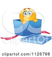 Cartoon Of A Cute Emoticon Smiley In A Gift Box Royalty Free Vector Clipart