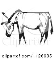 Clipart Of A Donkey Black And White Woodcut Royalty Free Vector Illustration