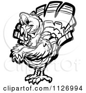 Cartoon Of A Black And White Turkey Bird Mascot With Folded Arms Royalty Free Vector Clipart by Chromaco