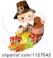 Cartoon Of A Cute Thanksgiving Pilgrim Boy With A Horn Of Plenty Cornucopia Royalty Free Vector Clipart