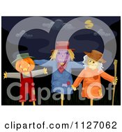 Cartoon Of A Creepy Halloween Scarecrows Under A Night Sky Royalty Free Vector Clipart