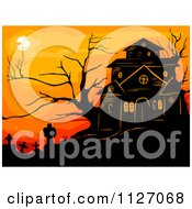 Haunted House With Spooky Bare Trees And Tombstones Against An Orange Sky